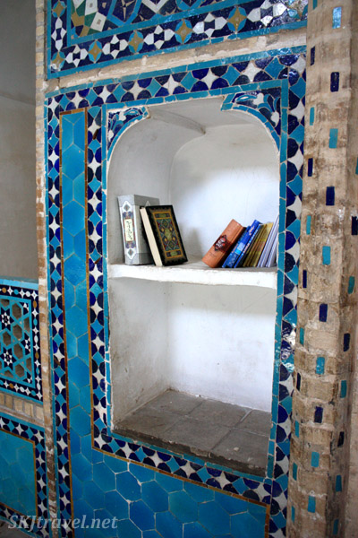 Books on a shelf inside Friday mosque in Yazd, Iran.