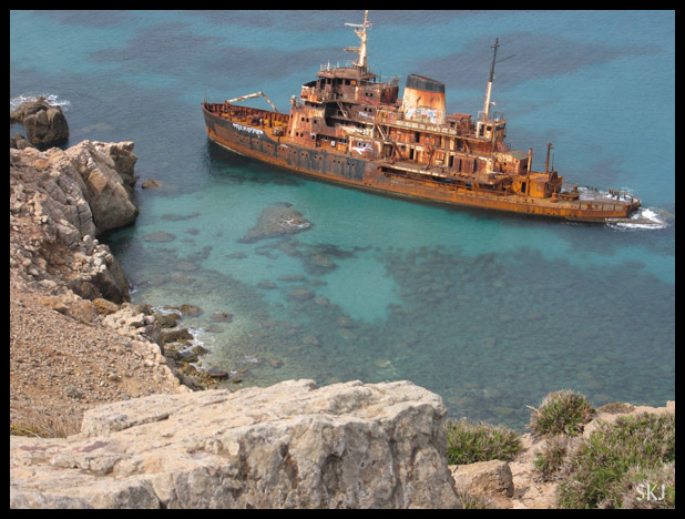Rusted ship wrecked and abandoned off the shore of Cap Bon, Tunisia.