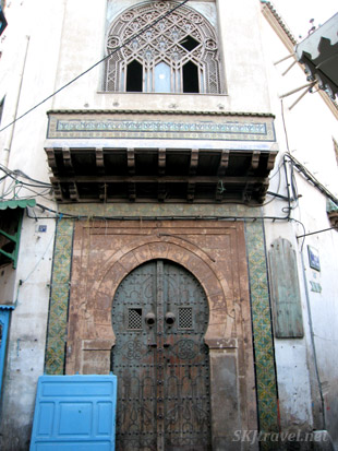Door and upper story window with elaborate lattice work in medina in Tunis Tunisia. photo by Shara Johnson