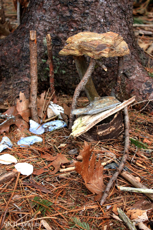 Small structure of sticks and bark called a fairy house, Maine. Photo by Shara Johnson