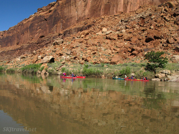 Canoeing through the reflection of the canyon wall on the Green River, Utah.