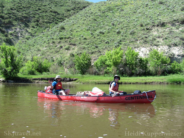 Erik and Shara managing their canoe down the Yamp River, Colorado.